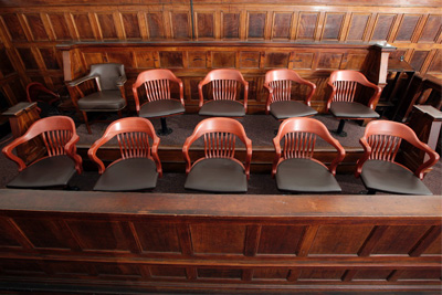 photo of a chairs in a jury box